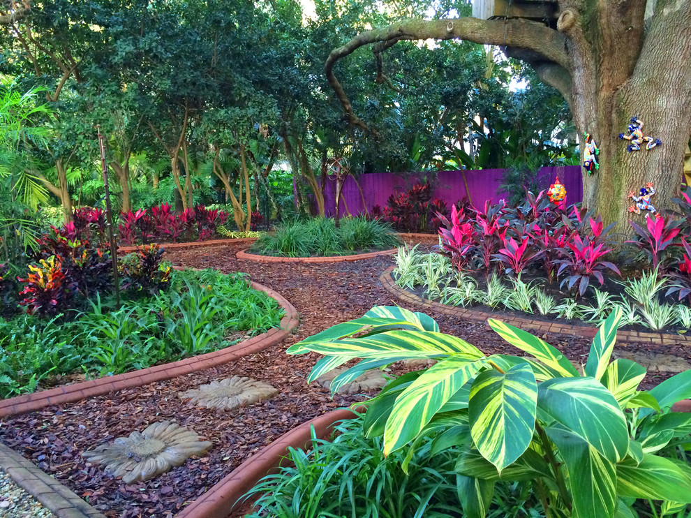 Inspiration for a mediterranean shade mulch garden path in Tampa.