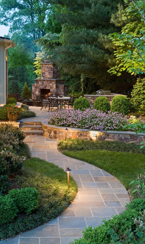 A sophisticated no grass backyard more towards the traditional layout.