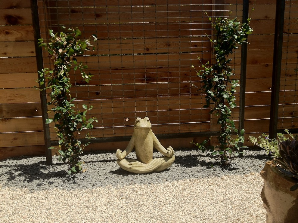 Design ideas for a small asian backyard gravel landscaping in Austin.