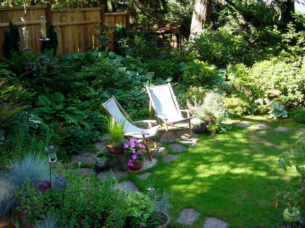 Photo of a small traditional shade backyard landscaping in Portland.