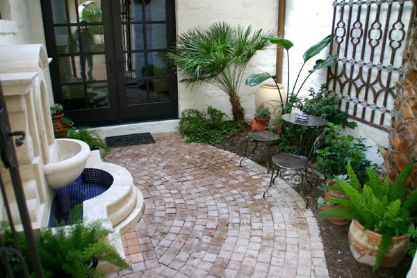 Spanish style courtyard with wall fountain mediterranean for Spanish style fountains for sale