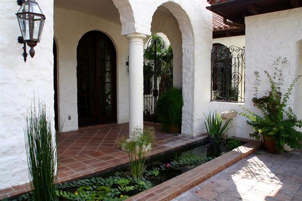 Spanish Styled Courtyard With Koi Pond Mediterranean