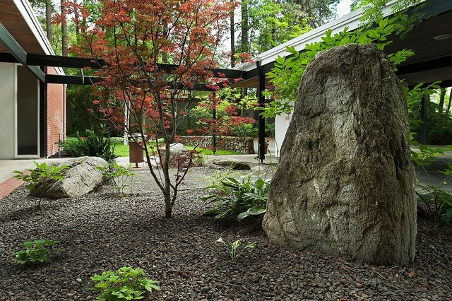 This is an example of a midcentury modern shade landscaping for fall. - Spokane Midcentury - Mary Jean & Joel E. Ferris, II House