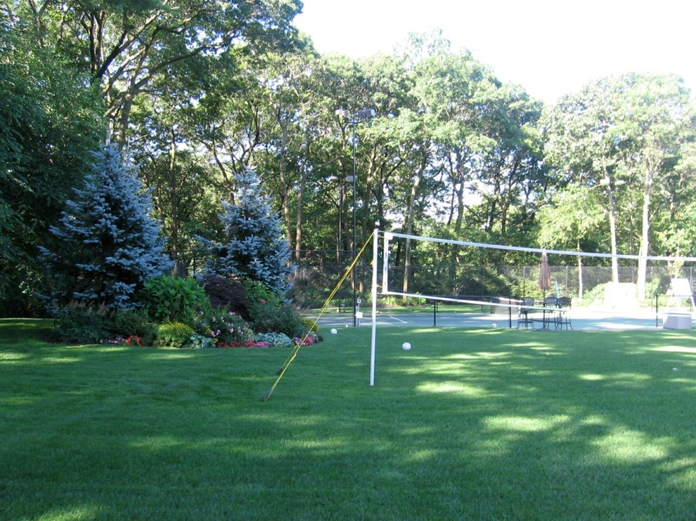 This is an example of a traditional backyard outdoor sport court in New York.