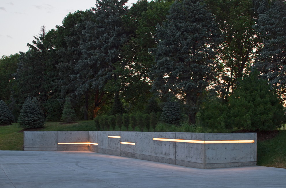Photo of a huge contemporary driveway in Omaha.