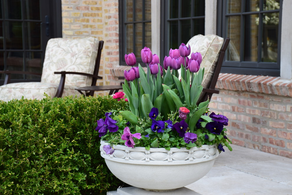 This is an example of a large traditional full sun backyard stone landscaping in Chicago for spring.