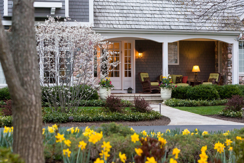Photo of a large transitional partial sun front yard stone landscaping in Chicago for spring.