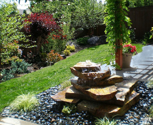 Captivating Stacked Rock Fountain Contemporary Landscape