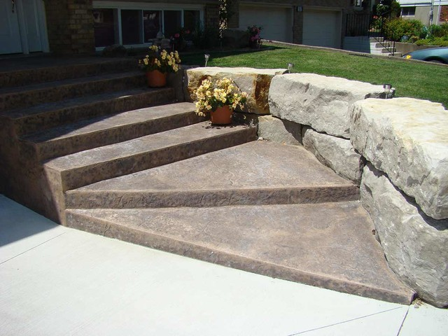 Stamped Concrete Steps With Armour Stone Retaining Wall