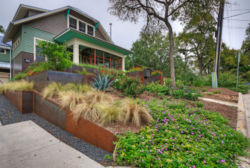This steel retaining wall was done by Pearson Landscape Services and  features all the things that make Austin, TX great: Texas mountain laurel,  ... - 7 Of The Coolest Landscape Designs In Austin