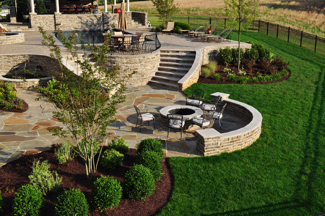Stone firepit and flagstone patio traditional landscape