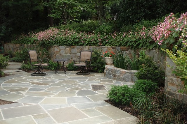 Water Retaining Walls : Stone patio with retaining wall and water feature