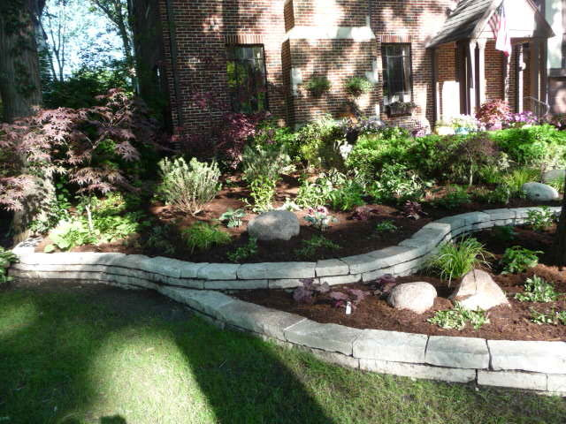Stone retaining walls, shady plantings traditional-landscape
