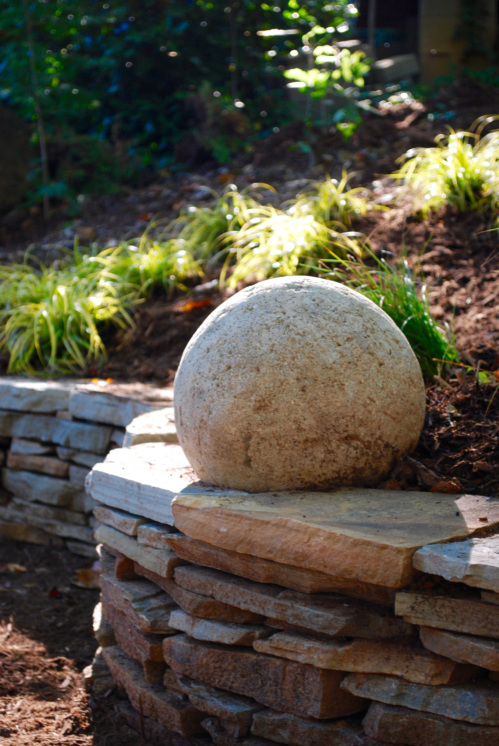 Stone sphere and serpentine wall.