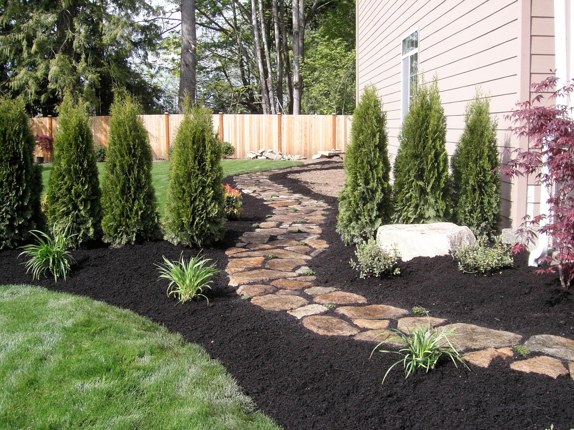 Stone walkway with beds, plants and lawn installed