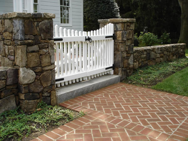 Stone Wall And White Picket Gate Traditional Landscape
