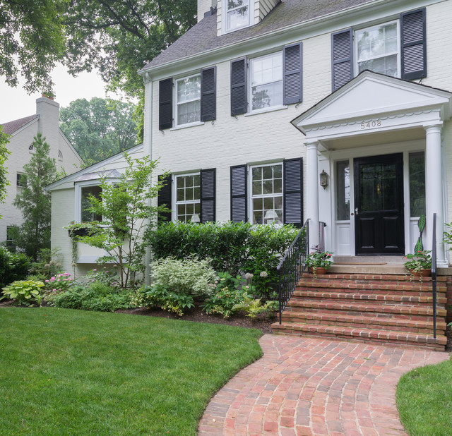Design ideas for a mid-sized traditional partial sun front yard brick landscaping in DC Metro for spring.