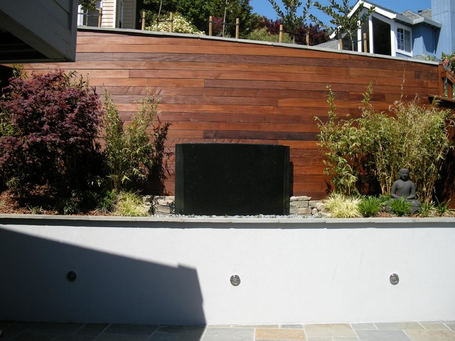 Stucco and ipe retaining wall contemporary landscape for Stucco garden wall designs