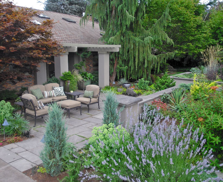 Photo of a mid-sized mediterranean partial sun front yard stone formal garden in Seattle with a fire pit for summer.