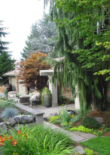 Inspiration for a large mediterranean full sun front yard stone landscaping in Seattle for summer.