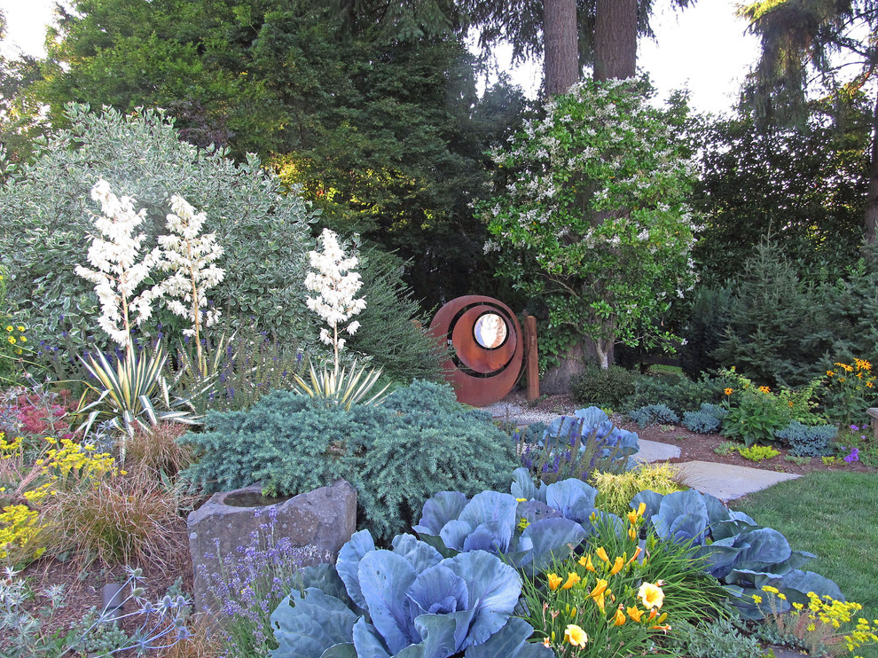 Design ideas for a huge mediterranean partial sun backyard stone formal garden in Seattle with a fire pit.