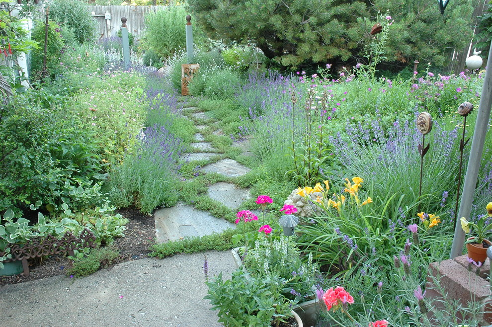 Inspiration for a mid-sized eclectic drought-tolerant and full sun backyard stone garden path in Salt Lake City for summer.