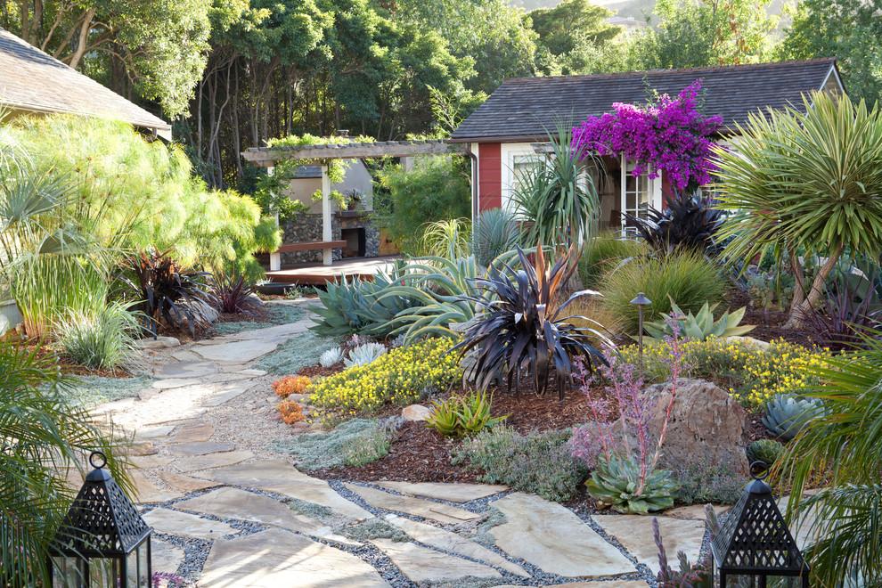 Inspiration for a mediterranean drought-tolerant backyard stone landscaping in San Luis Obispo.