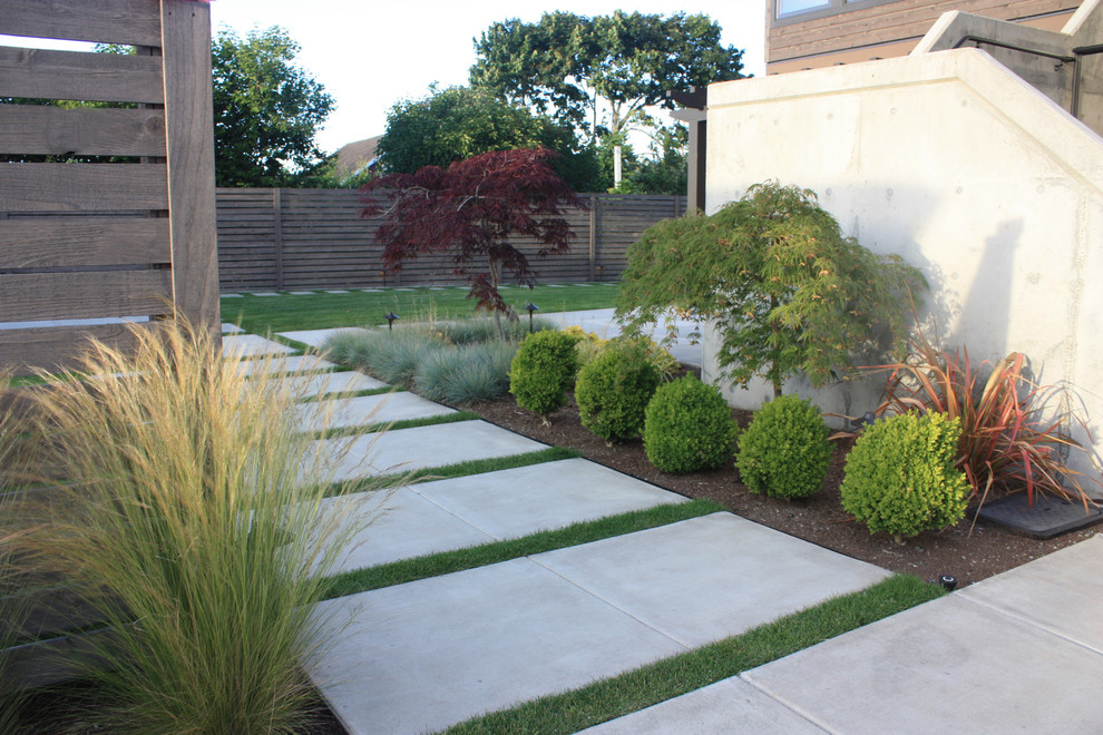Inspiration for a mid-sized contemporary full sun front yard concrete paver landscaping in Seattle.