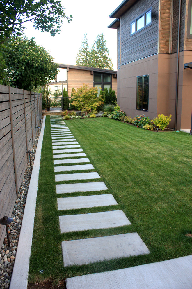 Photo of a mid-sized contemporary full sun front yard concrete paver landscaping in Seattle.