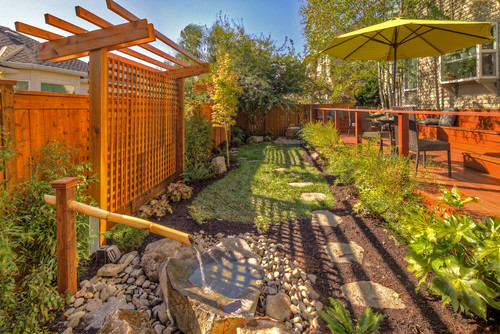 A high white lattice fence punctuates this well kept garden.