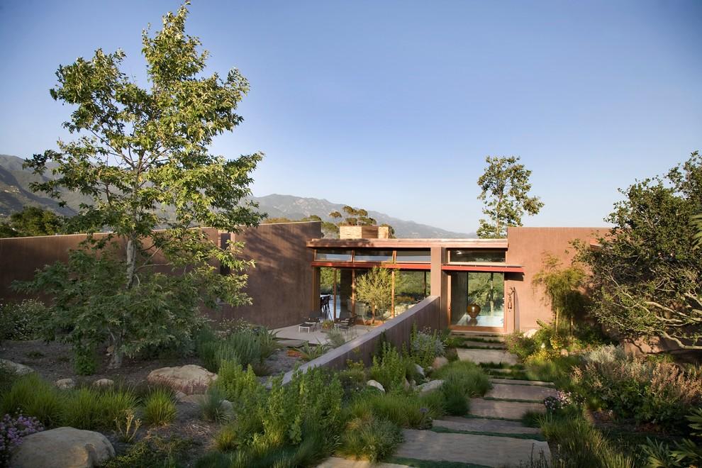 Photo of a contemporary drought-tolerant backyard landscaping in Santa Barbara.