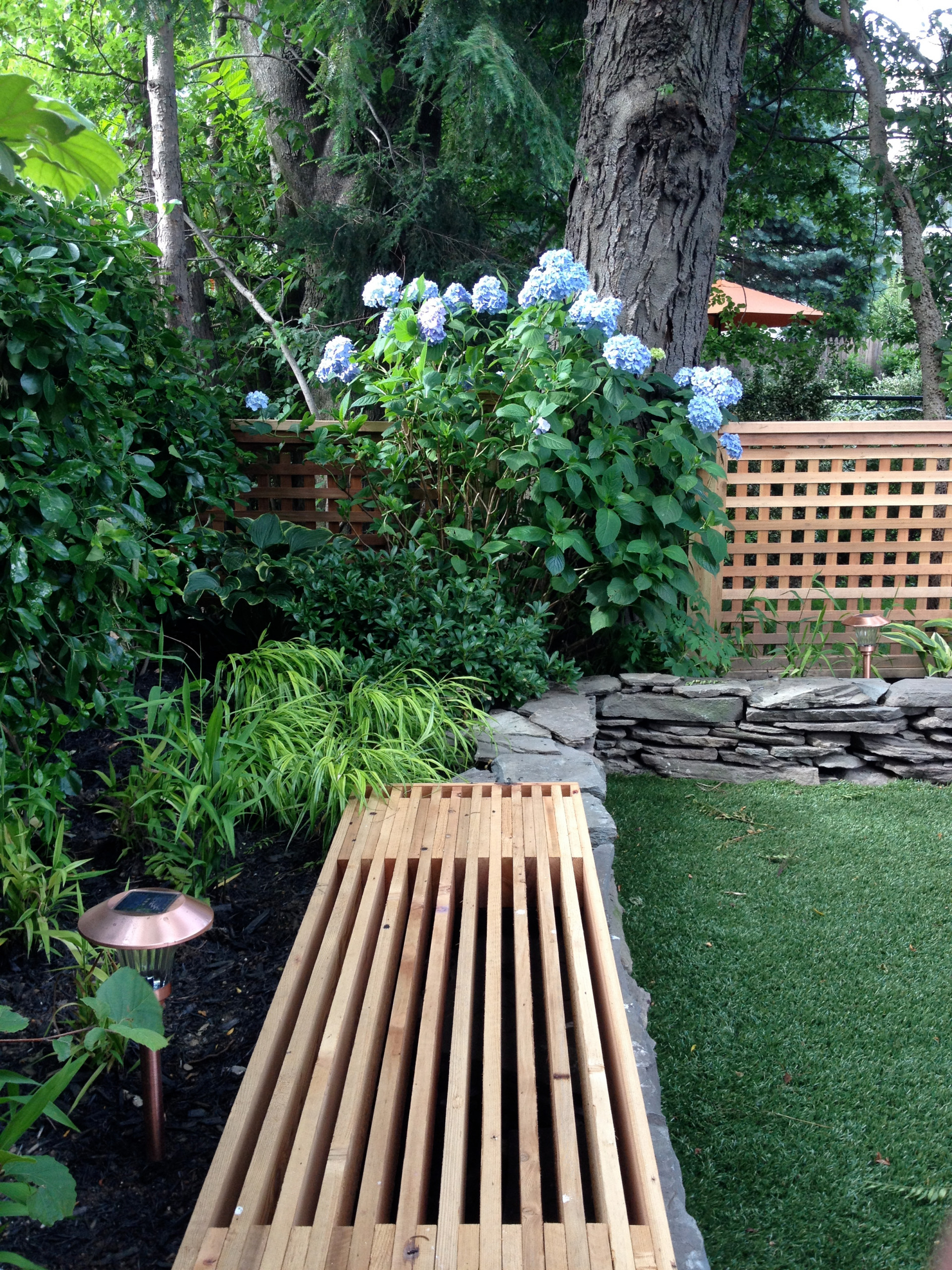 Synthetic Grass and Bluestone Raised Beds