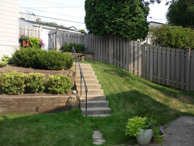 Terraced Backyard With Stairs And Paver Patio