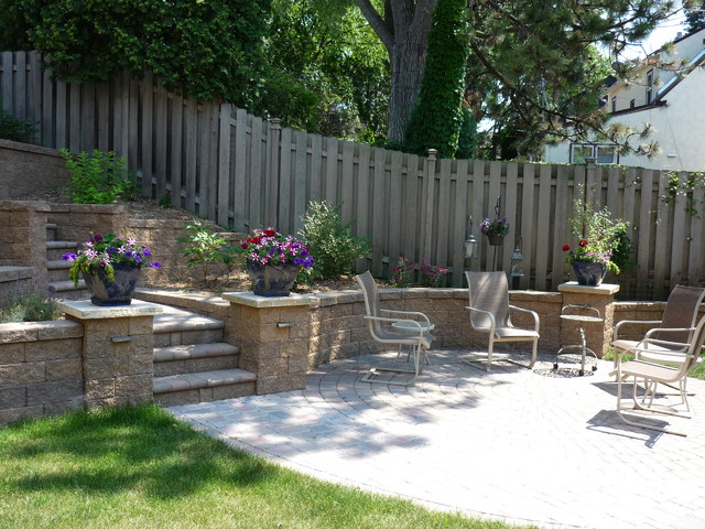 Terraced Backyard with Stairs and Paver Patio traditionallandscape