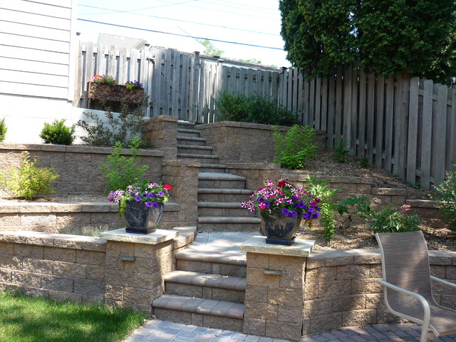 terraced backyard with stairs and paver patio traditional landscape