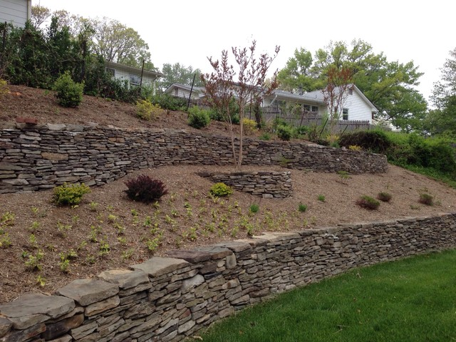 Terraced hillside with stone walls contemporary for Hillside landscaping