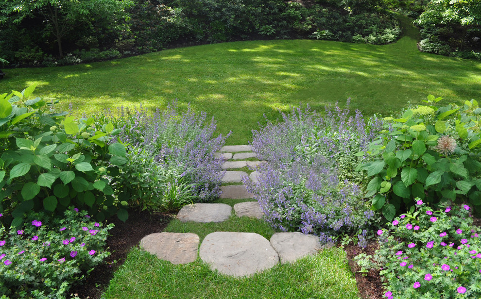 Design ideas for a mid-sized traditional partial sun hillside stone landscaping in Boston for summer.