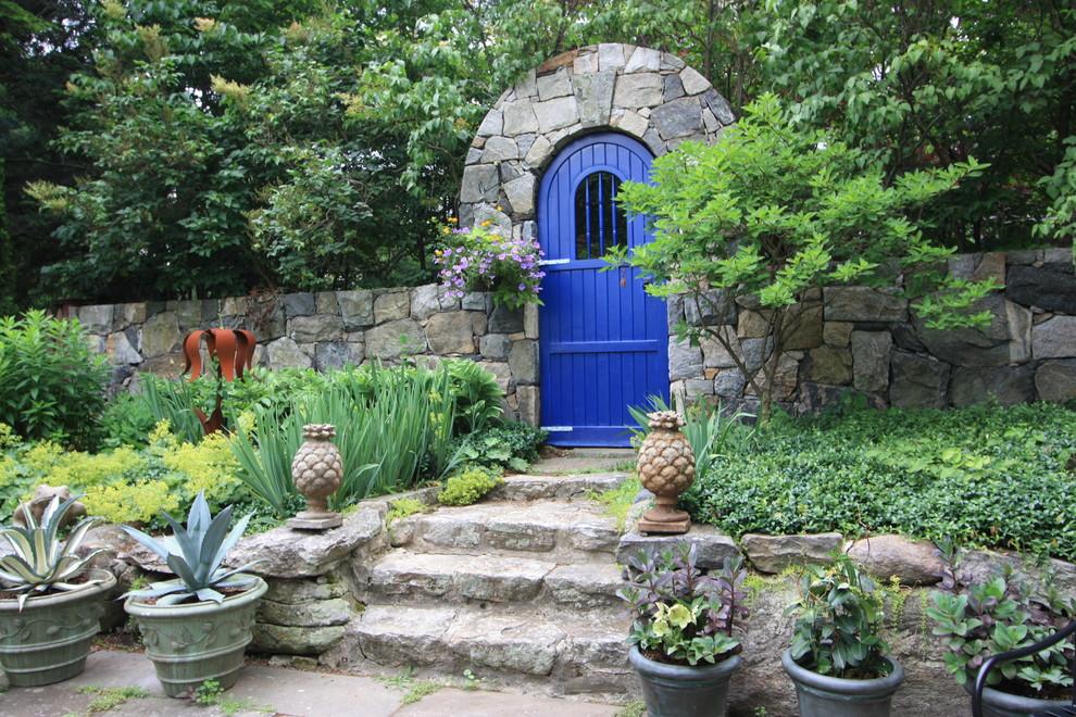 Design ideas for a traditional hillside garden path in Bridgeport.