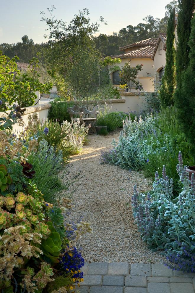 Inspiration for a mediterranean partial sun gravel garden path in Santa Barbara.