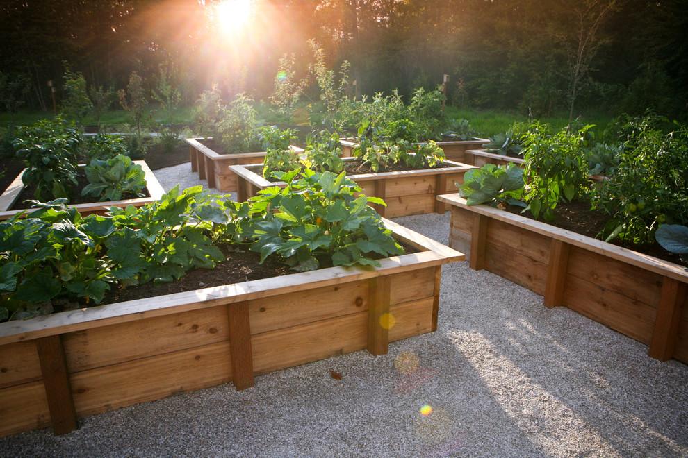 Design ideas for a farmhouse full sun vegetable garden landscape in Portland.
