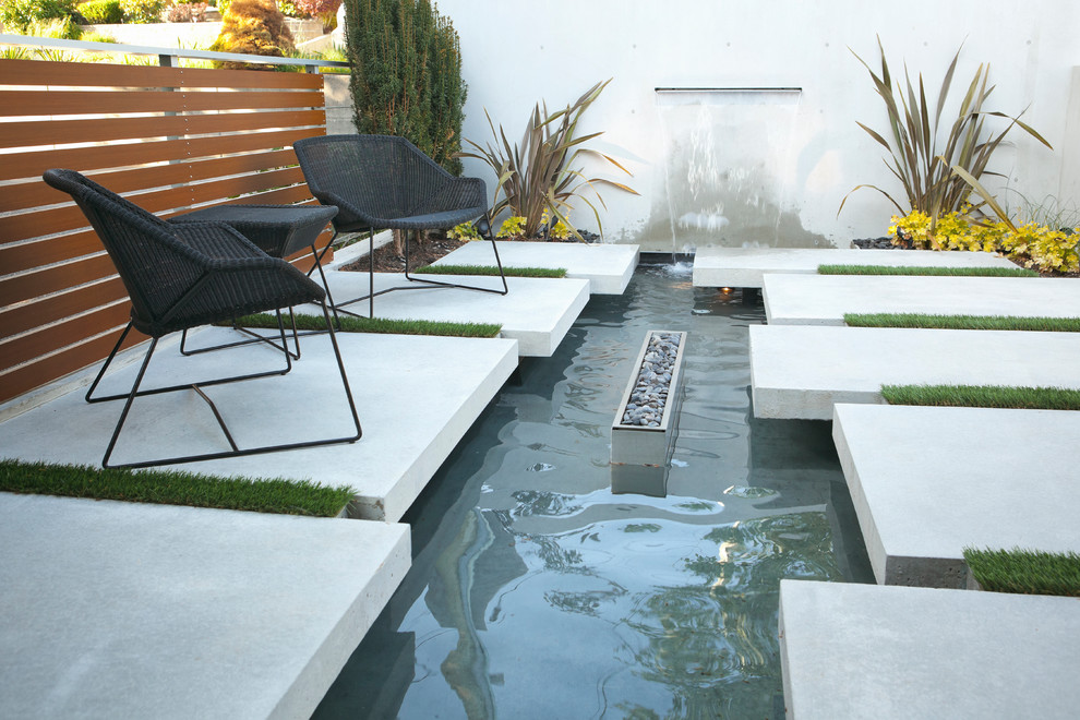Photo of a modern courtyard landscaping in Vancouver with a fire pit.