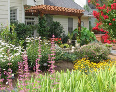 This Sanctuary Garden gives many reasons to enjoy the backyard traditional-landscape