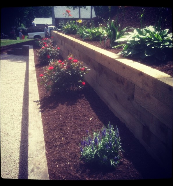 Tiered Plantings & Timber Wall Build traditional-landscape