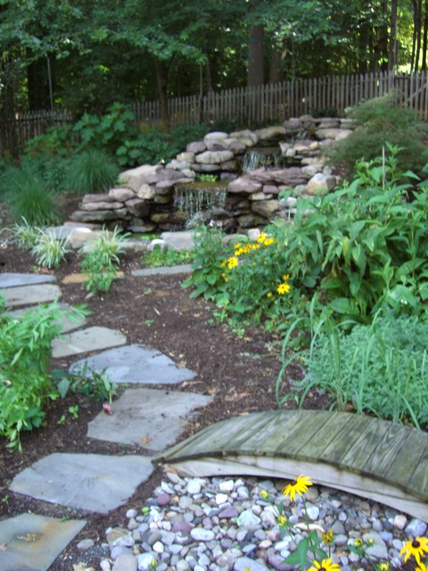 Tiered waterfall and garden contemporary landscape for Tiered pond waterfall
