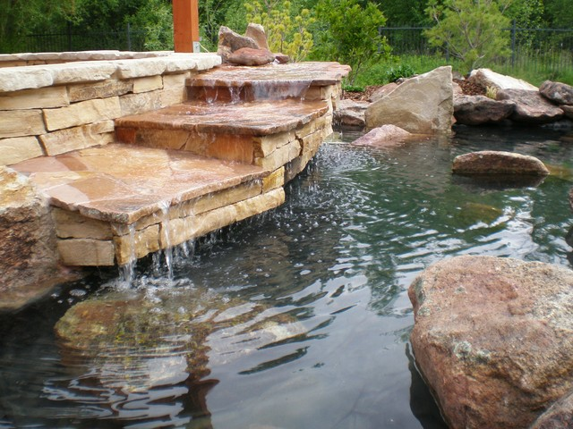 Tiered waterfall and turtle pond craftsman landscape for Tiered pond waterfall