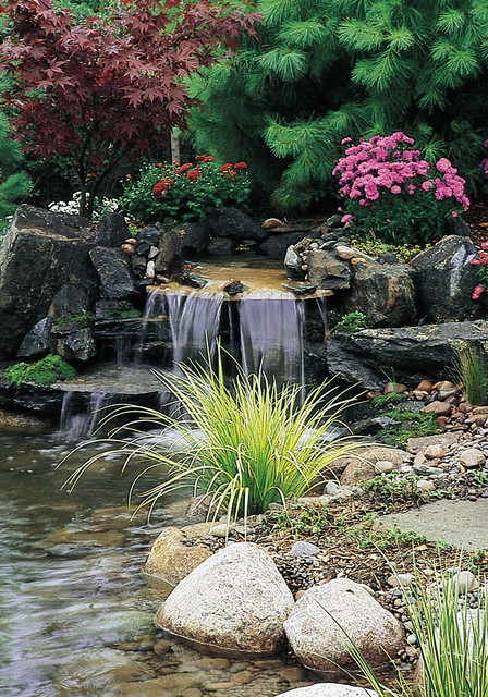 Tiered waterfall pond with stone hardscape and plantscape for Tiered pond waterfall