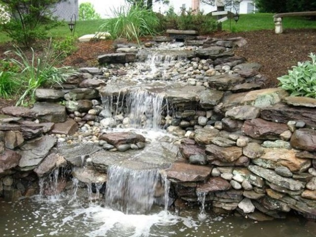 Tiered waterfalls and pond traditional landscape for Tiered pond waterfall