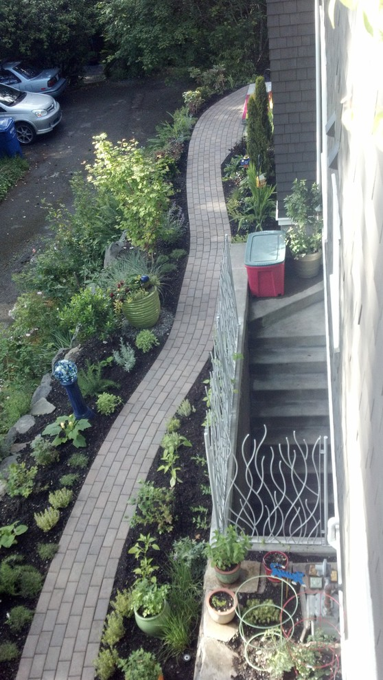 Photo of a small eclectic full sun side yard concrete paver vegetable garden landscape in Seattle.