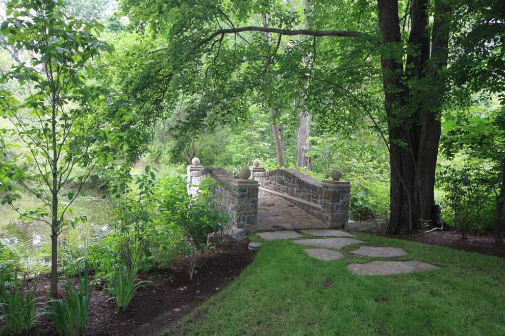 Inspiration for a traditional water fountain landscape in New York.