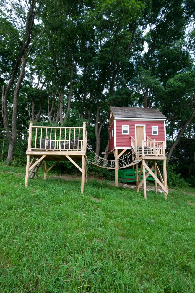 This is an example of a mid-sized traditional backyard outdoor playset in Manchester.